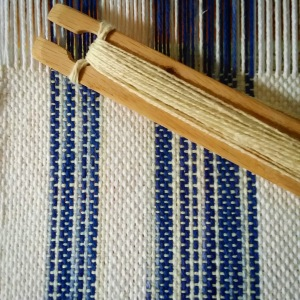 blue and white cotton weaving with shuttle